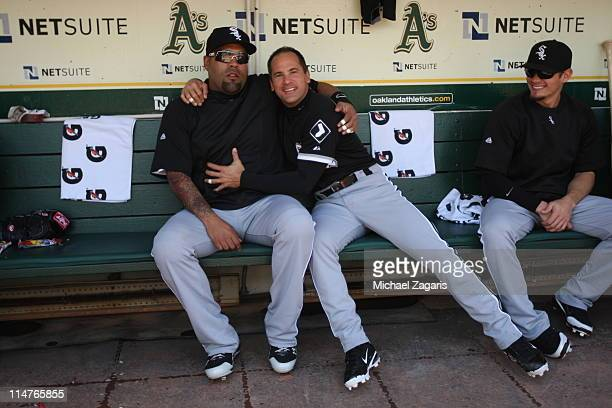 Ramon Castro and Omar Vizquel of the Chicago White Sox hang out in the dugout before the game against the Oakland Athletics at the OaklandAlameda...