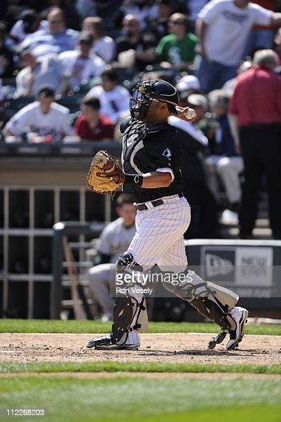 Ramon Castro of the Chicago White Sox catches against the Oakland Athletics on April 13 2011 at US Cellular Field in Chicago Illinois The Athletics...