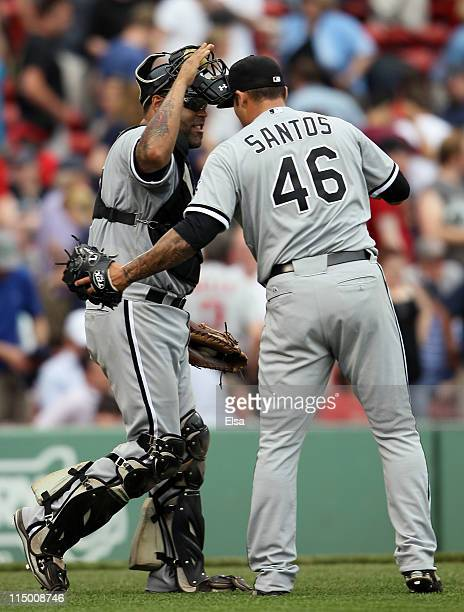 Ramon Castro of the Chicago White Sox celebrates the win with Sergio Santos after the game against the Boston Red Sox on June 1 2011 at Fenway Park...