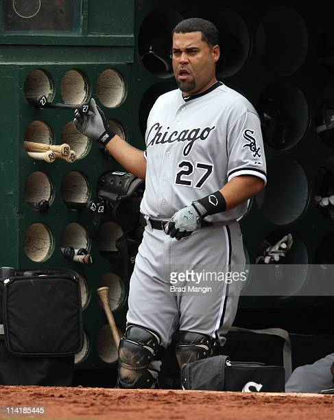 Ramon Castro of the Chicago White Sox grabs a bat in the dugout during the game against the Oakland Athletics at the OaklandAlameda County Coliseum...
