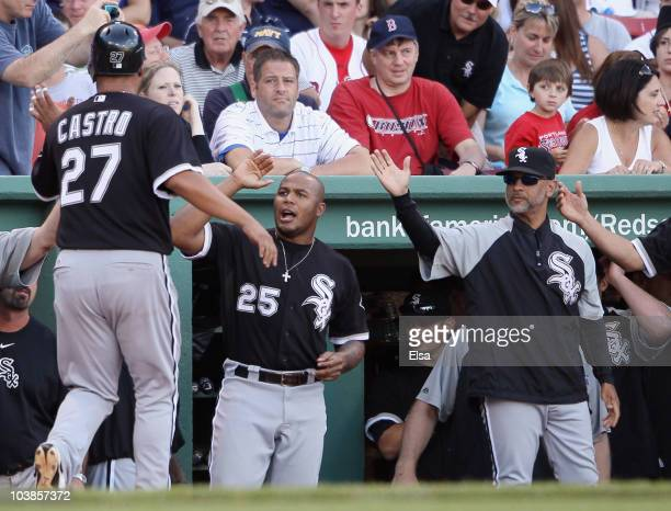 Ramon Castro of the Chicago White Sox is congratulated by Andruw Jones after Castro scored the game winning run on a bases loaded walk in the ninth...