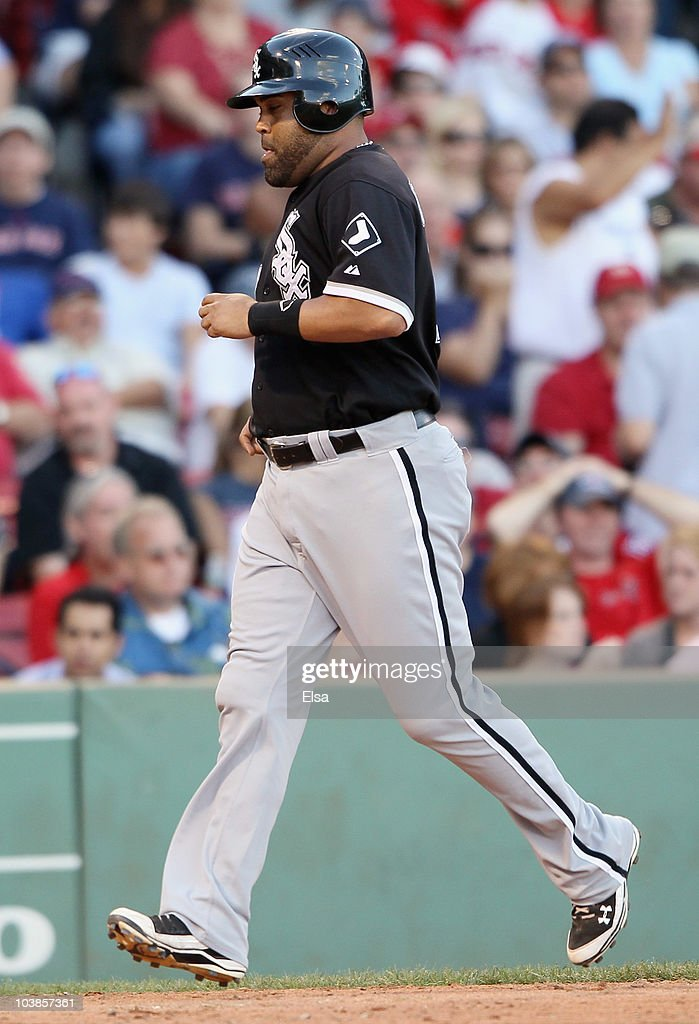 <a gi-track='captionPersonalityLinkClicked' href=/galleries/search?phrase=Ramon+Castro&family=editorial&specificpeople=208997 ng-click='$event.stopPropagation()'>Ramon Castro</a> #27 of the Chicago White Sox scored the game winning run on a bases loaded walk in the ninth inning against the Boston Red Sox September 5, 2010 at Fenway Park in Boston, Massachusetts.