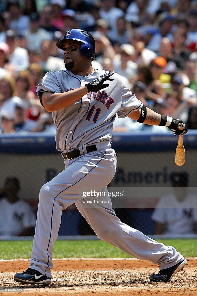 <a gi-track='captionPersonalityLinkClicked' href=/galleries/search?phrase=Ramon+Castro&family=editorial&specificpeople=208997 ng-click='$event.stopPropagation()'>Ramon Castro</a> #11 of the New York Mets singles on a line drive to left to score <a gi-track='captionPersonalityLinkClicked' href=/galleries/search?phrase=David+Wright+-+Baseball+Player&family=editorial&specificpeople=209172 ng-click='$event.stopPropagation()'>David Wright</a> in the 4th inning against the New York Yankees at Yankee Stadium on July 1, 2006 in Bronx, New York. The Mets defeated the Yankees 8-3.