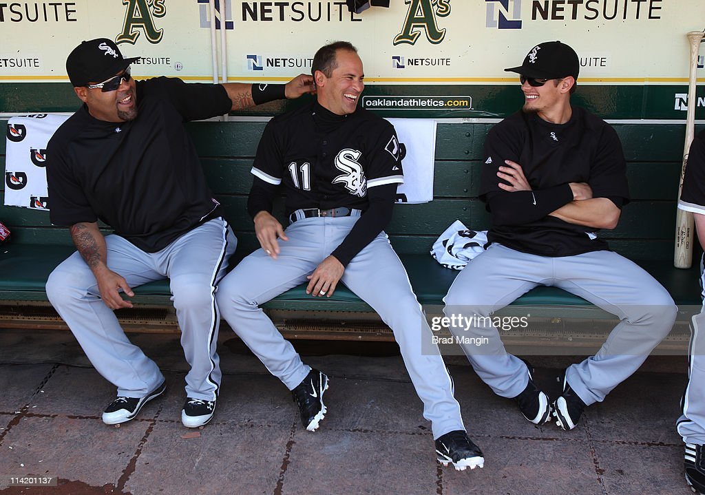 Ramon Castro #27, Omar Vizquel #11, and Brent Lillibridge #18 of the Chicago White Sox get ready in the dugout before the game against the Oakland Athletics at the Oakland-Alameda County Coliseum on May 15, 2011 in Oakland, California.