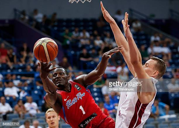 Ramon Clemente of Puerto Rico in action against Anzejs Pasecniks of Latvia during the 2016 FIBA World Olympic Qualifying basketball Semi Final match...