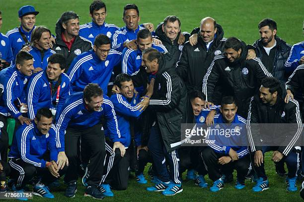 Ramon Diaz coach of Paraguay jokes with players during a training session at Alcaldesa Ester Roa Rebolledo Municipal Stadium on June 26 2015 in...