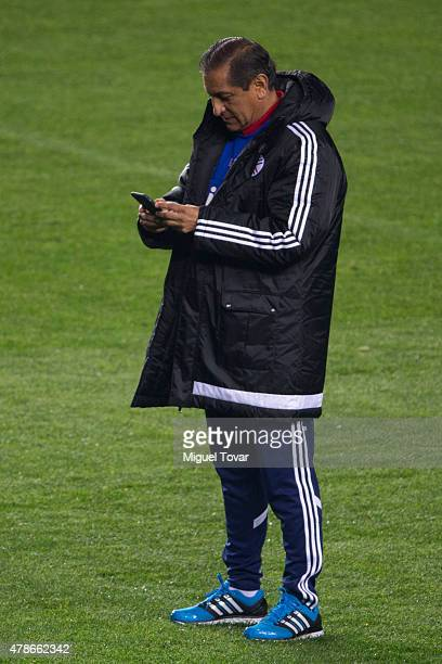 Ramon Diaz coach of Paraguay watches his phone before a training session at Alcaldesa Ester Roa Rebolledo Municipal Stadium on June 26 2015 in...