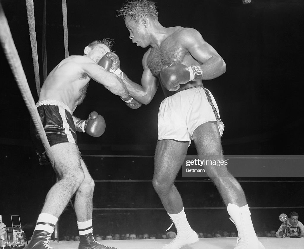 Ramon Fuentes almost loses his mouthpiece as he catches a right uppercut to the jaw from Cuban Isaac Logart in the sixth round of their welterweight...