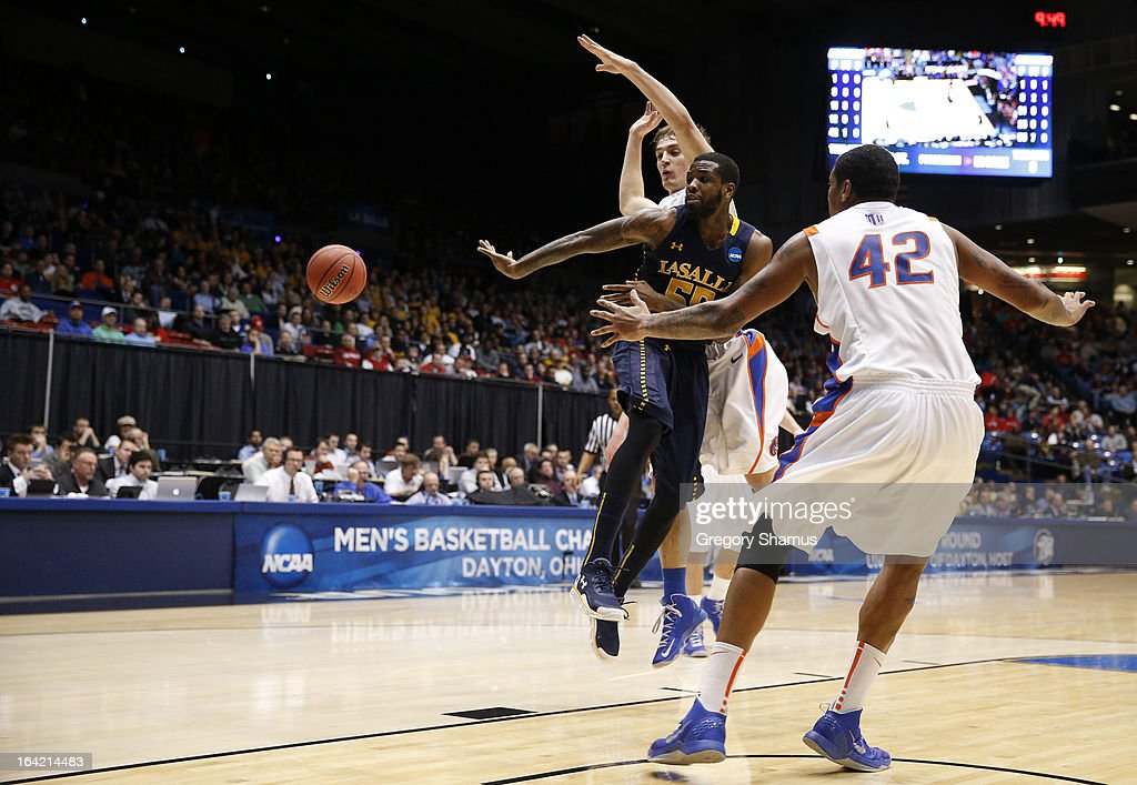 Ramon Galloway #55 of the La Salle Explorers passes the ball against Kenny Buckner #42 of the Boise State Broncos in the first half during the first round of the 2013 NCAA Men's Basketball Tournament at University of Dayton Arena on March 20, 2013 in Dayton, Ohio.