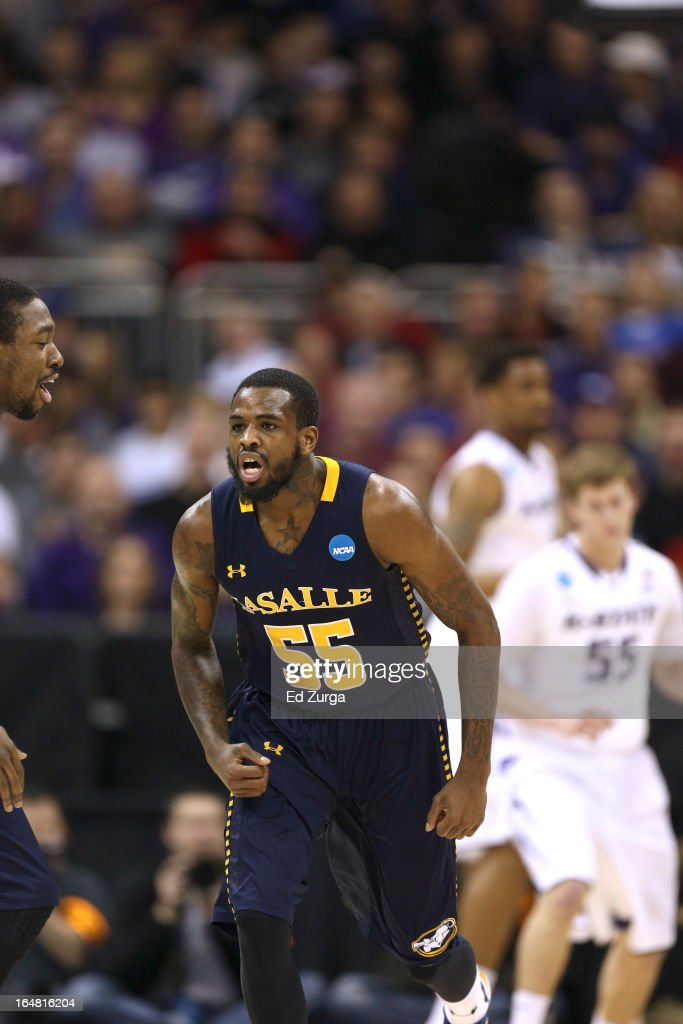 <a gi-track='captionPersonalityLinkClicked' href=/galleries/search?phrase=Ramon+Galloway&family=editorial&specificpeople=6835811 ng-click='$event.stopPropagation()'>Ramon Galloway</a> #55 of the La Salle Explorers reacts to a tree point shot against the Kansas State Wildcats during the second round of the 2013 NCAA Men's Basketball Tournament at the Sprint Center on March 22, 2013 in Kansas City, Missouri.