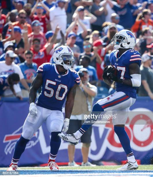 Ramon Humber of the Buffalo Bills and teammate Tre'Davious White celebrate during an NFL game against the Denver Broncos on September 24 2017 at New...