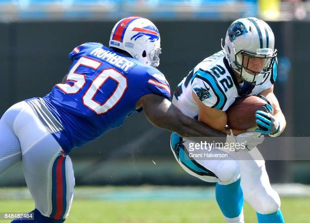 Ramon Humber of the Buffalo Bills tackles Christian McCaffrey of the Carolina Panthers during their game at Bank of America Stadium on September 17...