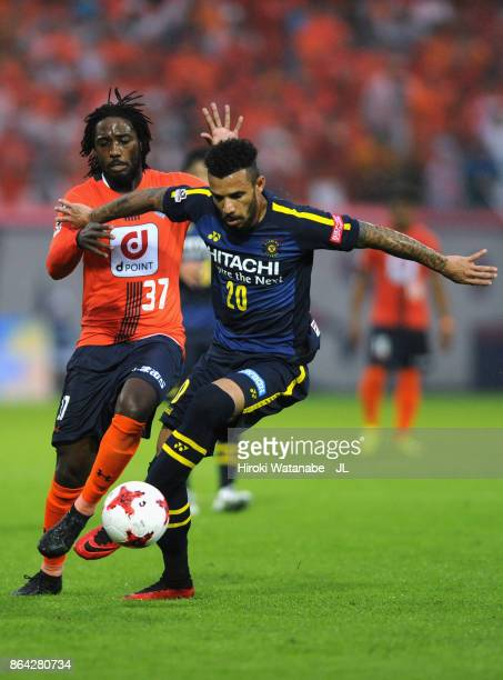 Ramon Lopes of Kashiwa Reysol and Caue of Omiya Ardija compete for the ball during the JLeague J1 match between Omiya Ardija and Kashiwa Reysol at...