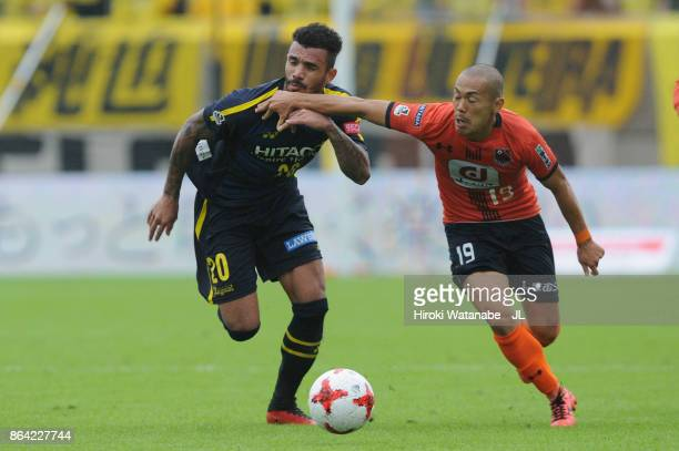 Ramon Lopes of Kashiwa Reysol and Ryo Okui of Omiya Ardija compete for the ball during the JLeague J1 match between Omiya Ardija and Kashiwa Reysol...