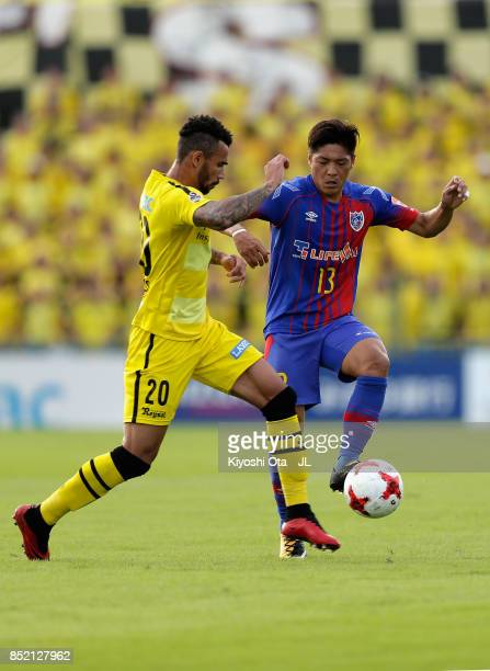 Ramon Lopes of Kashiwa Reysol and Yoshito Okubo of FC Tokyo compete for the ball during the JLeague J1 match between Kashiwa Reysol and FC Tokyo at...