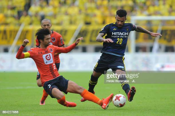 Ramon Lopes of Kashiwa Reysol is tackled by Kosuke Kikuchi of Omiya Ardija during the JLeague J1 match between Omiya Ardija and Kashiwa Reysol at...