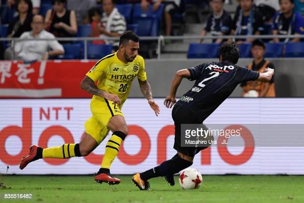 Ramon Lopes of Kashiwa Reysol takes on Genta Miura of Gamba Osaka during the JLeague J1 match between Gamba Osaka and Kashiwa Reysol at Suita City...