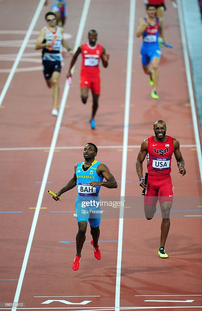 Ramon Miller (L) of the Bahamas approaches the finish line ahead of Angelo Taylor of the United States during the Men's 4 x 400m Relay Final on Day 14 of the London 2012 Olympic Games at Olympic Stadium on August 10, 2012 in London, England.