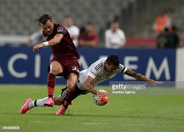 Ramon Motta of Besiktas vies for the ball with Yusuf Erdogan of Trabzonspor during the Turkish Spor Toto Super League football match between Besiktas...