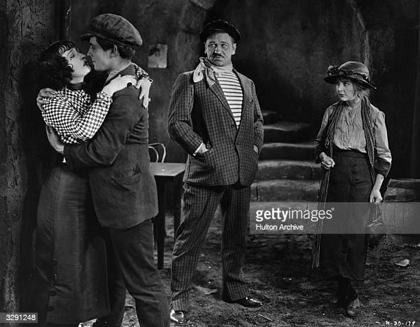 Ramon Novarro Enid Bennett and Wallace Beery in a scene from the film 'Red Lily' directed by Fred Niblo for MGM