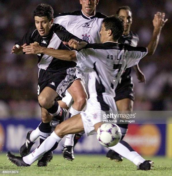 Ramon of Vasco Da Gama rides a challenge from the Corinthian's defender Adilson in the final of the FIFA World Club Championship at the Maracana...