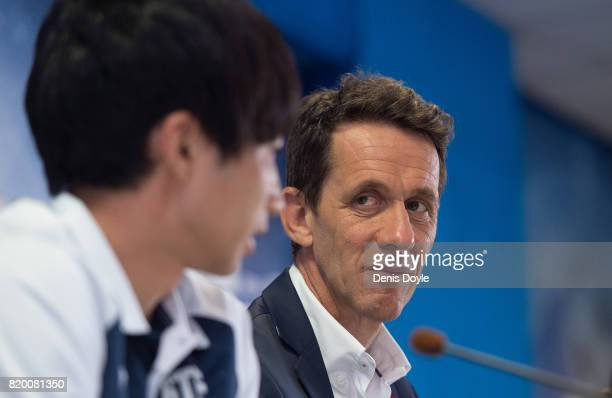 Ramon Planes Sports Director of Getafe CF SAD look towards the club's new signing Gaku Shibasaki during an unveiling to the press at Coliseum Alfonso...