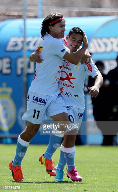 Ramon Rodriguez of Real Garcilaso celebrates with his teammate a scored goal against Sporting Cristal during a match between Real Garcilaso and...