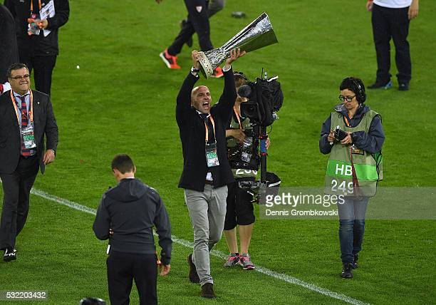 Ramon Rodriguez Verdejo director of football of Sevilla lifts the trophy after the UEFA Europa League Final match between Liverpool and Sevilla at St...