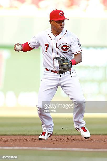 Ramon Santiago of the Cincinnati Reds fields a ground ball and makes the throw to first base during the game against the Philadelphia Phillies at...