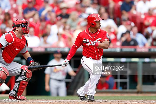 Ramon Santiago of the Cincinnati Reds hits into a fielder's choice to drive in a run in the eighth inning of the game against the the St Louis...