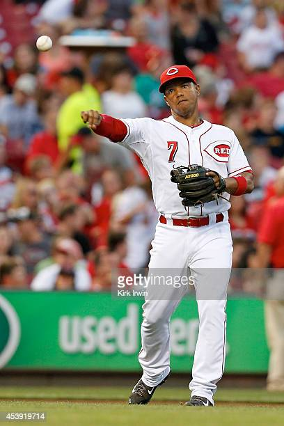 Ramon Santiago of the Cincinnati Reds throws the ball to first base during the game against the Miami Marlins at Great American Ball Park on August 8...