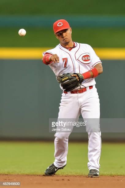 Ramon Santiago of the Cincinnati Reds throws to first base against the Arizona Diamondbacks at Great American Ball Park on July 29 2014 in Cincinnati...