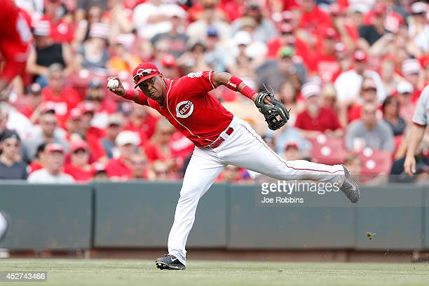 Ramon Santiago of the Cincinnati Reds tries to make a play at third base in the seventh inning of the game against the Washington Nationals at Great...
