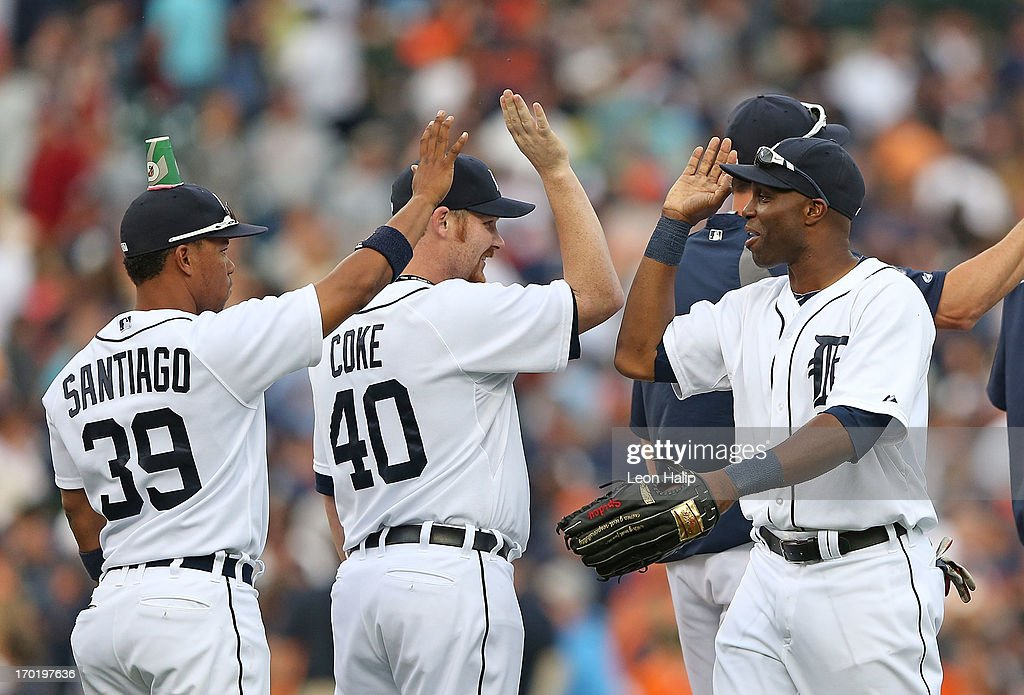 <a gi-track='captionPersonalityLinkClicked' href=/galleries/search?phrase=Ramon+Santiago&family=editorial&specificpeople=2984417 ng-click='$event.stopPropagation()'>Ramon Santiago</a> #39 of the Detroit Tigers celebrates a win over the Ceveland Indians with his teammates wearing a Gatorade Cup as a team prank after the Tigers defeated the Indians at Comerica Park on June 8, 2013 in Detroit, Michigan. The Tigers defeated th Indians 6-4.