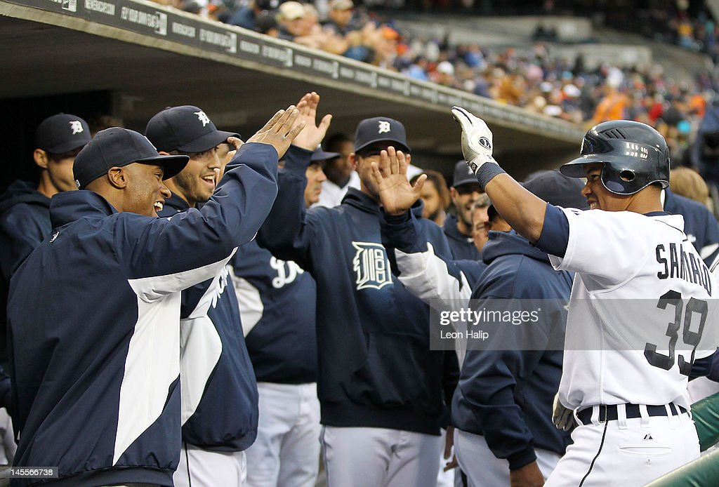 <a gi-track='captionPersonalityLinkClicked' href=/galleries/search?phrase=Ramon+Santiago&family=editorial&specificpeople=2984417 ng-click='$event.stopPropagation()'>Ramon Santiago</a> #39 of the Detroit Tigers celebrates with his teammates after hitting a third inning solo home run during the game against the New York Yankees at Comerica Park on June 1, 2012 in Detroit, Michigan. The Yankees defeated the Tigers 9-4.