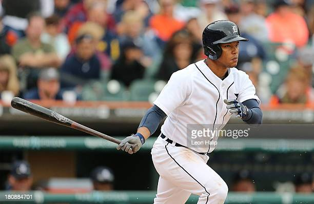 Ramon Santiago of the Detroit Tigers singles to center field during the second inning of the game against the Kansas City Royals at Comerica Park on...