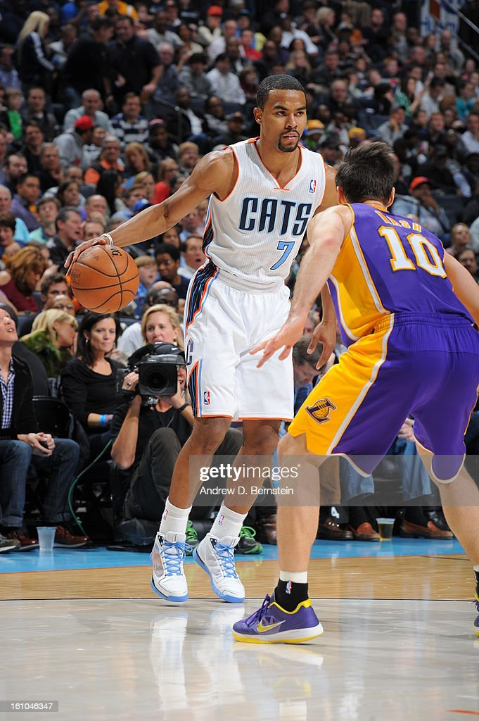 Ramon Sessions #7 of the Charlotte Bobcats controls the ball against Steve Nash #10 of the Los Angeles Lakers on February 8, 2013 at the Time Warner Cable Arena in Charlotte, North Carolina.