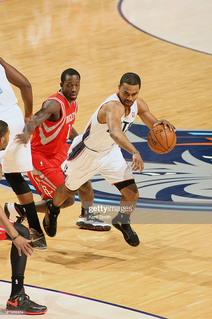 <a gi-track='captionPersonalityLinkClicked' href=/galleries/search?phrase=Ramon+Sessions&family=editorial&specificpeople=805440 ng-click='$event.stopPropagation()'>Ramon Sessions</a> #7 of the Charlotte Bobcats drives around Patrick Beverley #12 of the Houston Rockets at the Time Warner Cable Arena on January 21, 2013 in Charlotte, North Carolina.