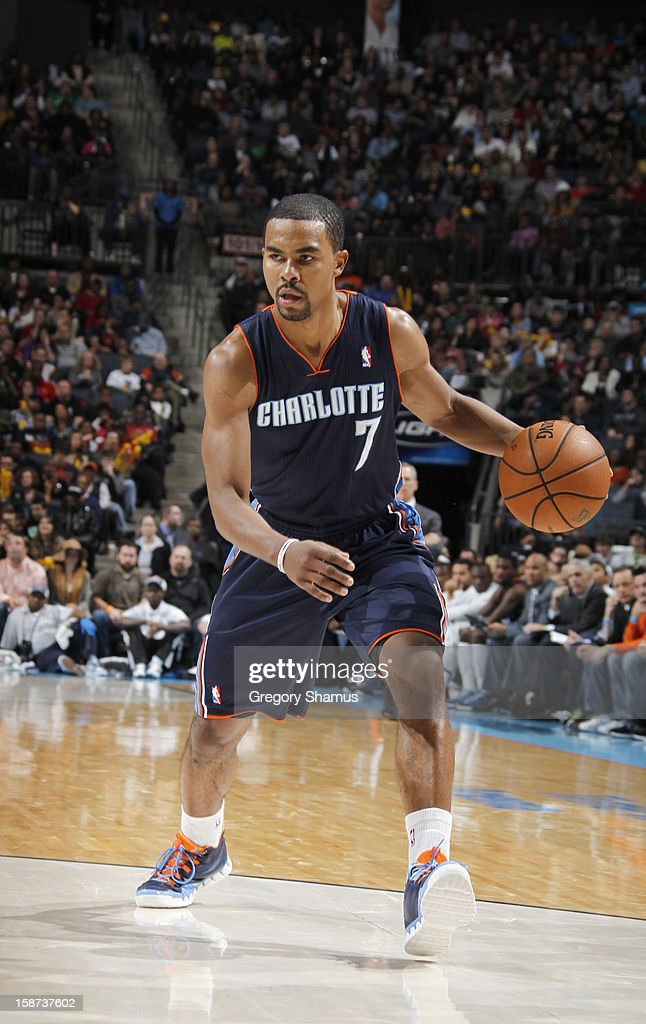 <a gi-track='captionPersonalityLinkClicked' href=/galleries/search?phrase=Ramon+Sessions&family=editorial&specificpeople=805440 ng-click='$event.stopPropagation()'>Ramon Sessions</a> #7 of the Charlotte Bobcats drives during the game between the Miami Heat and the Charlotte Bobcats at the Time Warner Cable Arena on December 26, 2012 in Charlotte, North Carolina.