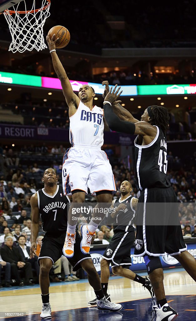 Ramon Sessions #7 of the Charlotte Bobcats drives past Gerald Wallace #45 of the Brooklyn Nets during their game at Time Warner Cable Arena on March 6, 2013 in Charlotte, North Carolina.