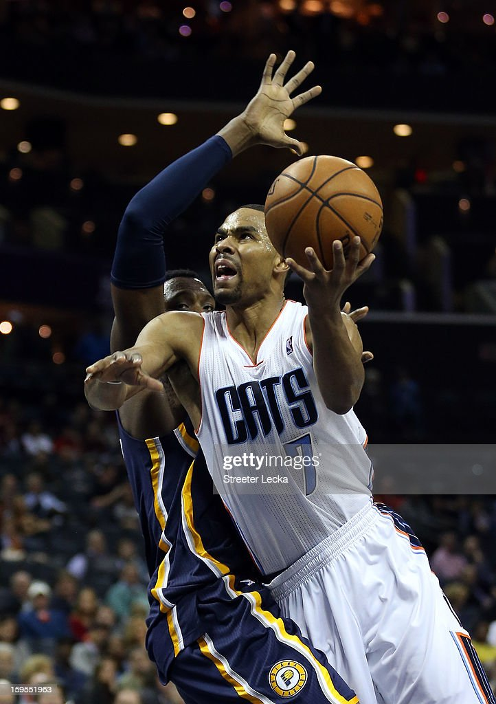Ramon Sessions #7 of the Charlotte Bobcats drives past Jeff Pendergraph #29 of the Indiana Pacers during their game at Time Warner Cable Arena on January 15, 2013 in Charlotte, North Carolina.