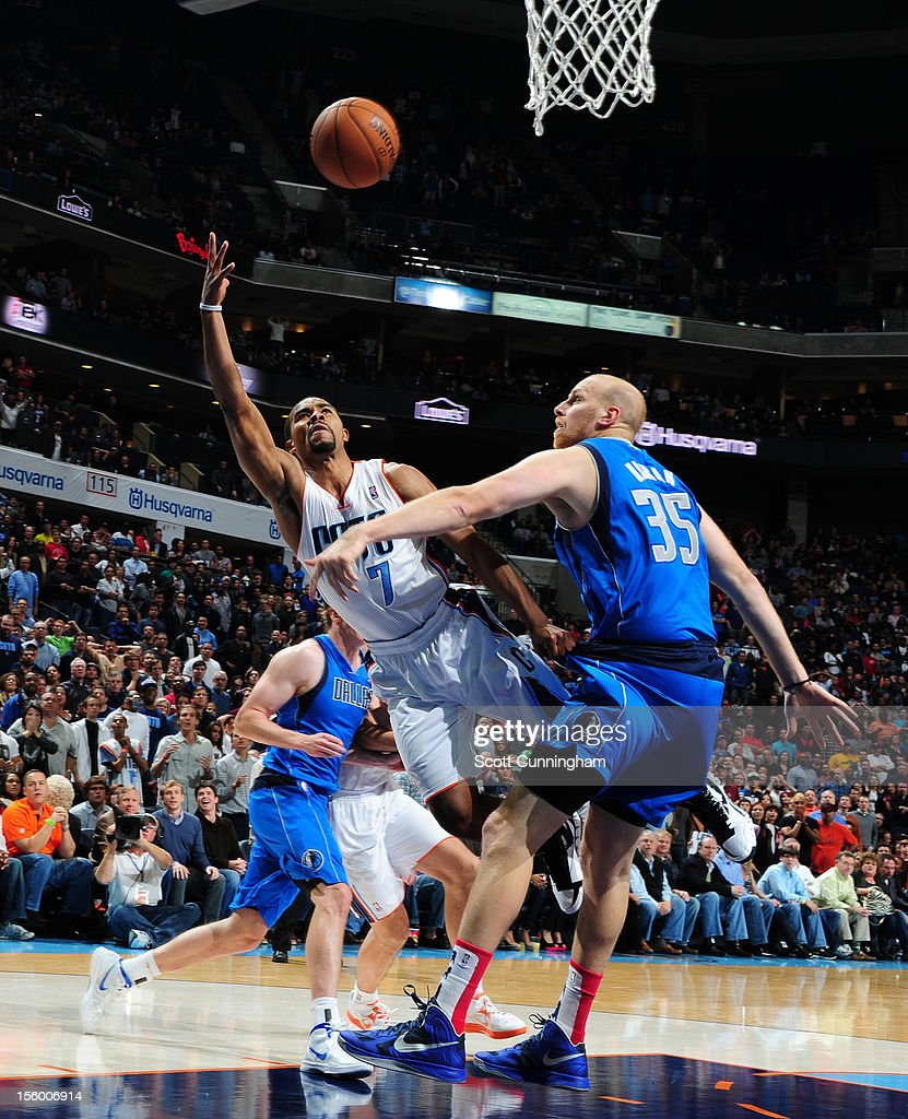 Ramon Sessions #7 of the Charlotte Bobcats drives to the basket against the Dallas Mavericks at Time Warner Cable Arena on November 10, 2012 in Charlotte, North Carolina.
