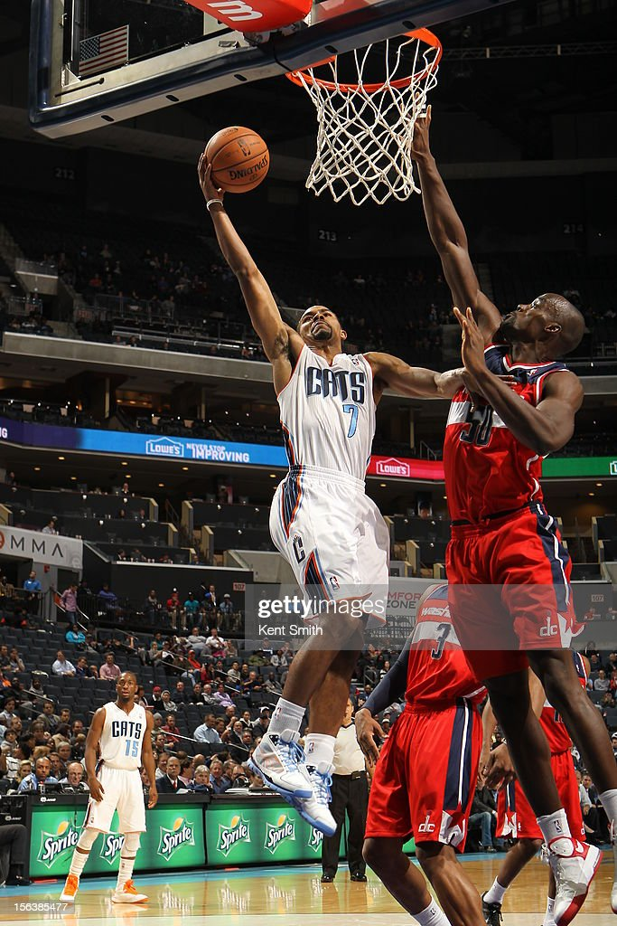 <a gi-track='captionPersonalityLinkClicked' href=/galleries/search?phrase=Ramon+Sessions&family=editorial&specificpeople=805440 ng-click='$event.stopPropagation()'>Ramon Sessions</a> #7 of the Charlotte Bobcats drives to the basket against <a gi-track='captionPersonalityLinkClicked' href=/galleries/search?phrase=Emeka+Okafor&family=editorial&specificpeople=201739 ng-click='$event.stopPropagation()'>Emeka Okafor</a> of the Washington Wizards at the Time Warner Cable Arena on November 13, 2012 in Charlotte, North Carolina.