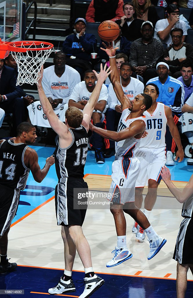 Ramon Sessions #7 of the Charlotte Bobcats drives to the basket against the San Antonio Spurs at Time Warner Cable Arena on December 8, 2012 in Charlotte, North Carolina.