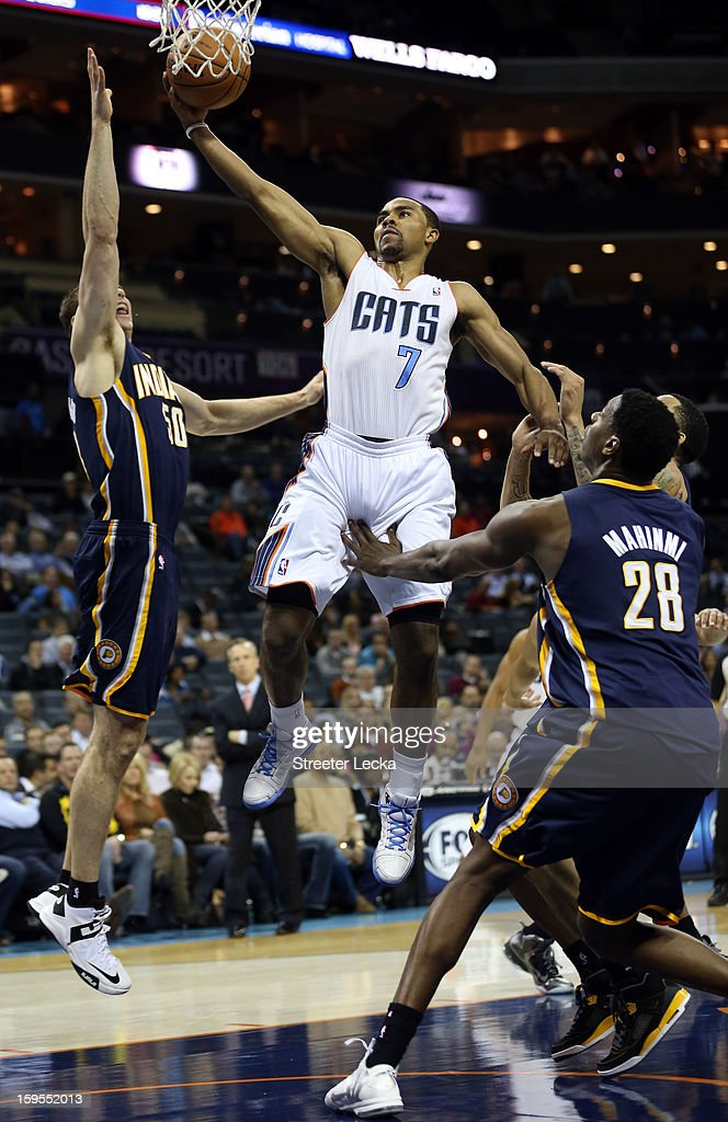 Ramon Sessions #7 of the Charlotte Bobcats drives to the basket against Tyler Hansbrough #50 of the Indiana Pacers during their game at Time Warner Cable Arena on January 15, 2013 in Charlotte, North Carolina.