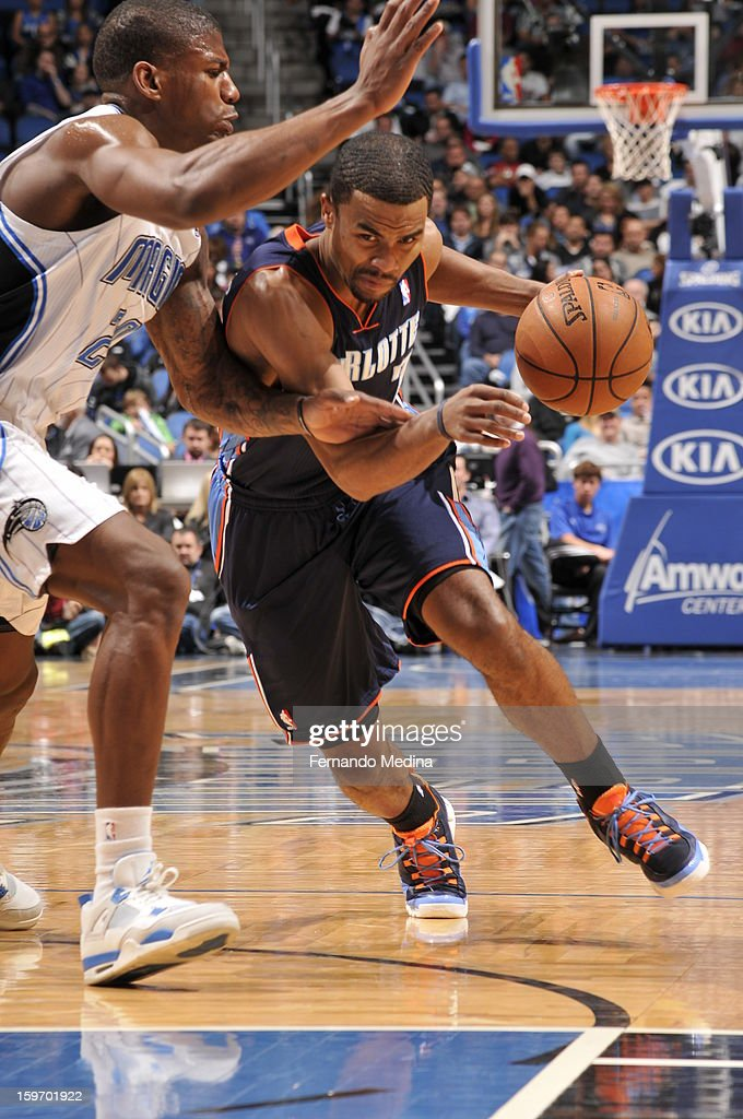 Ramon Sessions #7 of the Charlotte Bobcats drives to the basket against DeQuan Jones #20 of the Orlando Magic on January 18, 2013 at Amway Center in Orlando, Florida.