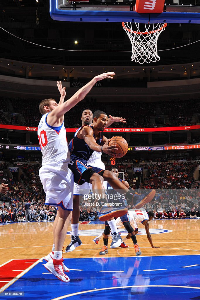 Ramon Sessions #7 of the Charlotte Bobcats drives to the basket against Spencer Hawes #00 of the Philadelphia 76ers during the game at the Wells Fargo Center on February 9, 2013 in Philadelphia, Pennsylvania.