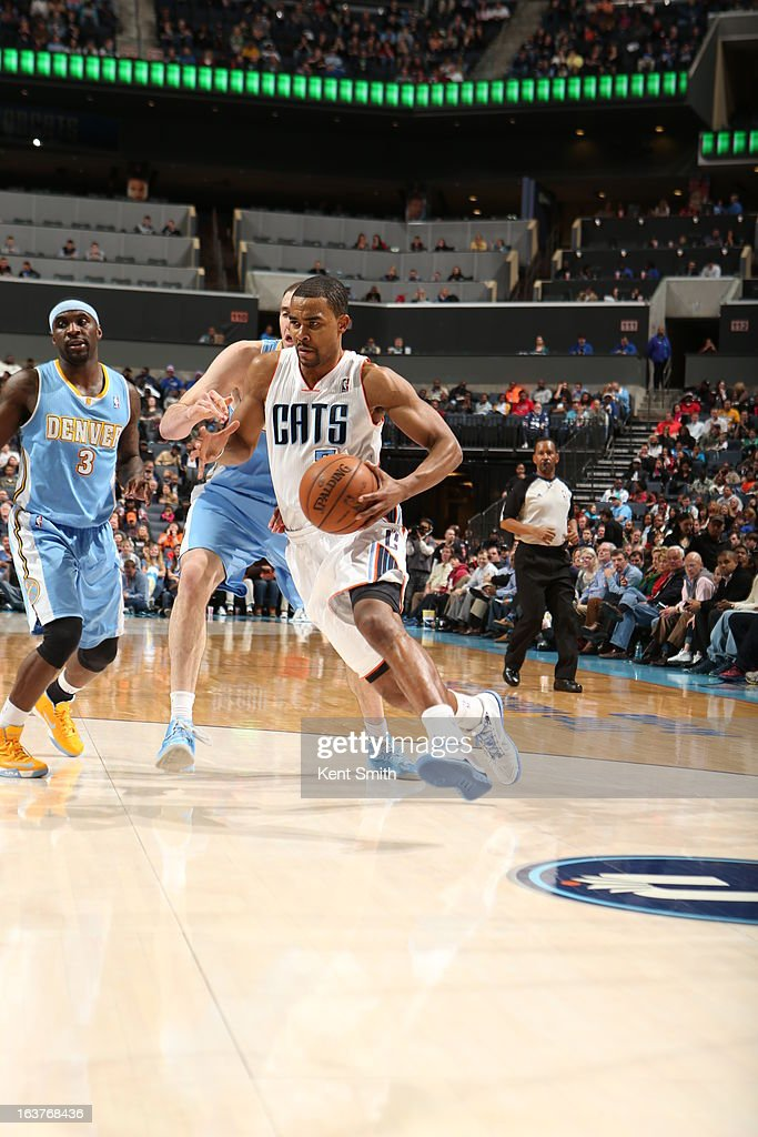 <a gi-track='captionPersonalityLinkClicked' href=/galleries/search?phrase=Ramon+Sessions&family=editorial&specificpeople=805440 ng-click='$event.stopPropagation()'>Ramon Sessions</a> #7 of the Charlotte Bobcats drives to the basket against the Denver Nuggets at the Time Warner Cable Arena on February 23, 2013 in Charlotte, North Carolina.