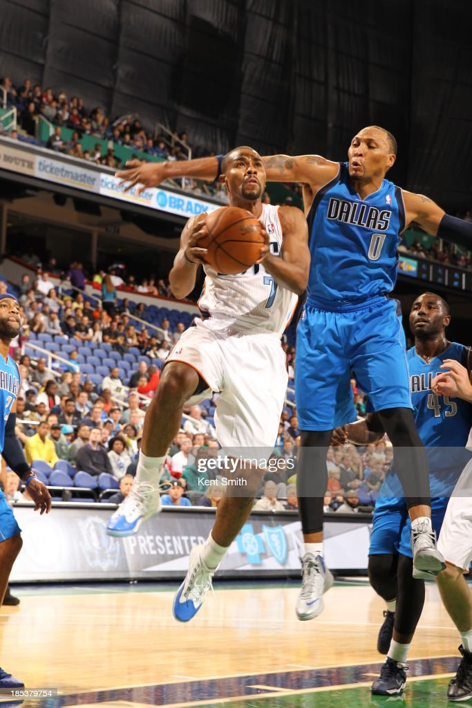 <a gi-track='captionPersonalityLinkClicked' href=/galleries/search?phrase=Ramon+Sessions&family=editorial&specificpeople=805440 ng-click='$event.stopPropagation()'>Ramon Sessions</a> #7 of the Charlotte Bobcats drives to the basket against <a gi-track='captionPersonalityLinkClicked' href=/galleries/search?phrase=Shawn+Marion&family=editorial&specificpeople=201566 ng-click='$event.stopPropagation()'>Shawn Marion</a> #0 of the Dallas Mavericks at the Greensboro Coliseum on October 19, 2013 in Greensboro, North Carolina.