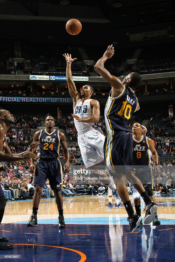 Ramon Sessions #7 of the Charlotte Bobcats drives to the basket and puts up a shot against the Utah Jazz at the Time Warner Cable Arena on January 9, 2013 in Charlotte, North Carolina.